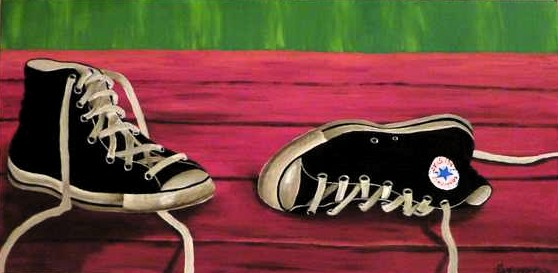 Noelle's Shoes realistic painting of a pair of shoes. They are black All Stars and lay on a red table. The background is green, canvas 60x20cm. by Lia van Elffenbrinck