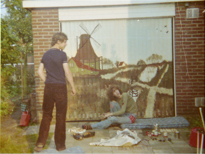 Me, 18 years old) sitting in front of the garage door which I overpainted as a surprise for my parents.
