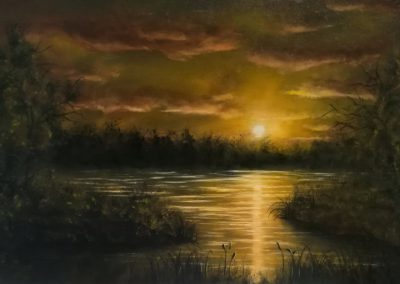 Golden Sun painting about a bright light shining on a lake. The yellow, green, orange colours are very brilliant